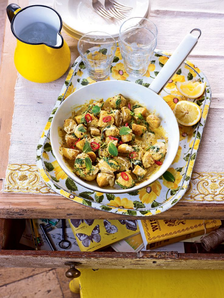 The potatoes in this spiced potato and spinach curry recipe take on a wonderful creaminess and provide the perfect host for the Indian inspired flavours.