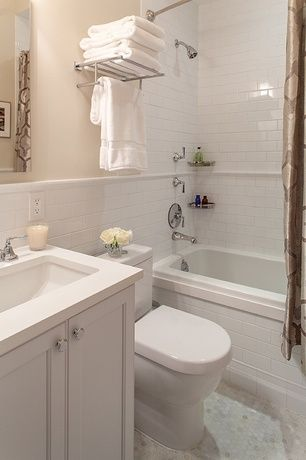 Traditional Full Bathroom with Large Ceramic Tile, Corian Solid Surface Countertop, penny tile floors, Ann Sacks Arden Cap