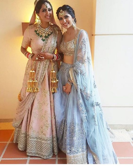 Major outfit goals! <3 This stunning bride with her baby pink lehenga looks so dreamy! It's be a dream come true getting this look on ths most special day of your life! The bridesmaid's outfit is on point too!  Beautiful <3