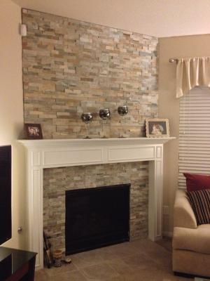 stone backsplash around fireplace need something to replace the ugly tile thats currently there