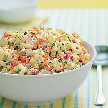 This colorful macaroni salad with tuna features grated carrot, chopped celery and red onion, all tossed in a creamy mayonnaise-yogurt dressing. Serve it chilled as a side salad or a main dish.