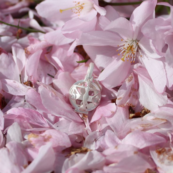 Globe of Libra in a blanket of cherry blossoms!  #1people #1peopletogether #danishdesign #jewellery #fashion #zodiac