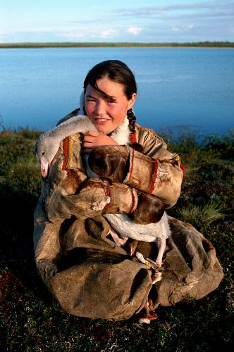 Alla, A Nenets girl, poses with her pet cygnet at a summer camp near Nadym, Yamal, W.Siberia, Russia