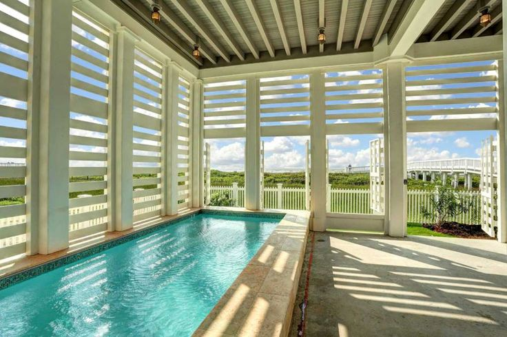 Beachfront homes in the Beachtown community in Galveston feature in-ground heated pools on the ground floor. Photo: TK Images