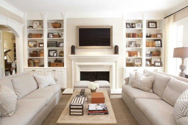 Framed tv . Shelves . Dual sofas