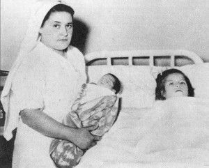 Lina Medina, age 5, in hospital after giving birth via caeserian section, to a 6 lb baby boy, named Gerardo, in Peru.