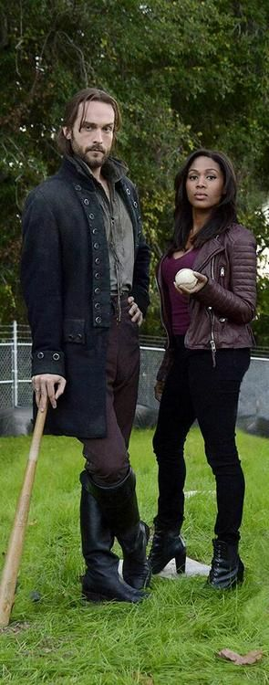 """Tom Mison as Ichabod Crane and Nichole BeHarie as Abbie Mills from the TV Show """"Sleepy Hollow""""."""
