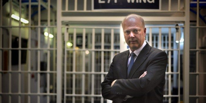 Almost where he belongs: But Injustice Minister Chris Grayling should be behind bars - not in front of them.