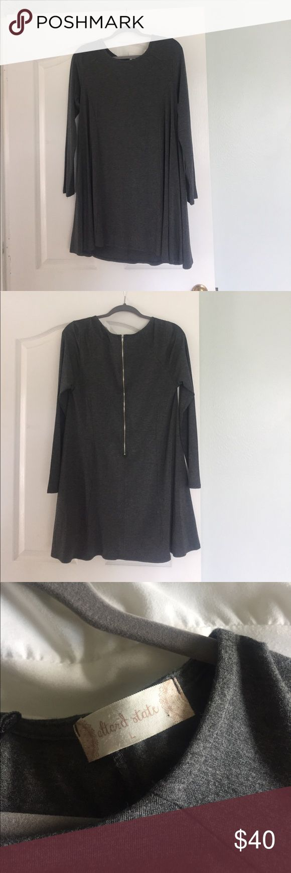 NWOT Altar'd state long sleeve charcoal grey dress This super soft charcoal grey dress is perfect for a cute-casual fall outfit! Thick cotton material and zipper back dress from altar'd state will become a wardrobe staple! Bought 2 months ago and never worn (it won't be cold enough in Texas until at least November). This dress hits me mid thigh and I am 5'8. All offers welcome! Altar'd State Dresses Long Sleeve