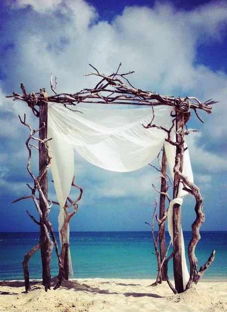 Driftwood Wedding Arch for beach wedding on Grace Bay Beach, Turks & Caicos - at Alexandra Resort.