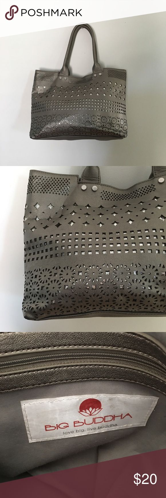 Big Buddha Cut-out purse Vegan leather silver laser cut out purse! Small lip stick stain on inner pocket (see pictures). Features multiple inside pockets and a middle divider. Snap closure. Big Buddha Bags Shoulder Bags