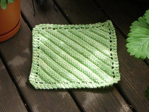 """A quick and easy twist on the traditional """"Grandmother's Favorite""""-type corner-to-corner washcloth. This version includes alternating stripes of stockinette and reverse stockinette for interest and texture. Gauge is not critical to this project, but size can be adjusted by going up or down needle sizes or using different yarn weights."""
