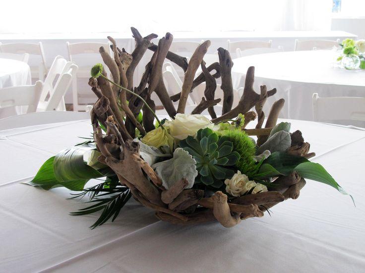 driftwood centerpieces wedding   These arrangements featured succulents, driftwood bowls, dusty miller ...