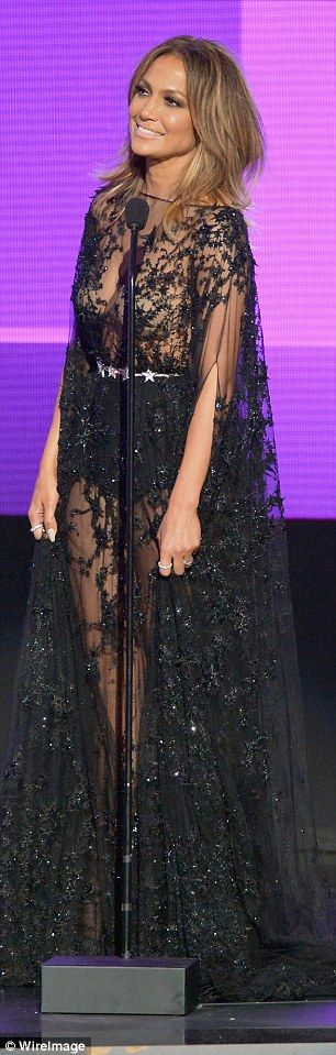 See-through: The singer's beige bra was clearly visible under her sheer black gown