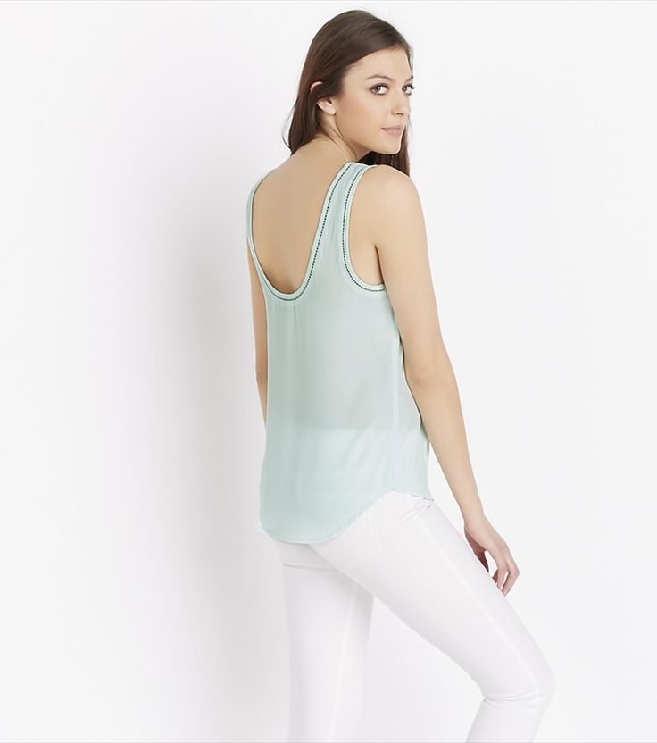Whether worn tucked into a skirt or with a pair of high waisted denim, no wardrobe is complete without this pastel tank.
