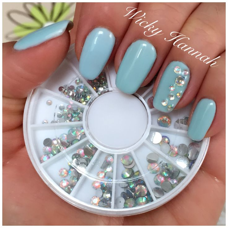 Clear Chrystal Rhinestones on Baby Blue Gel Polish nails.