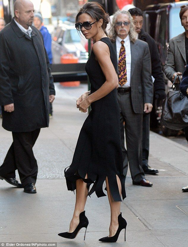 Glamorous on Good Morning: Victoria Beckham flexing her fashion muscles in a fitted black dress, as she arrived at the ABC studios in New York on Monday morning