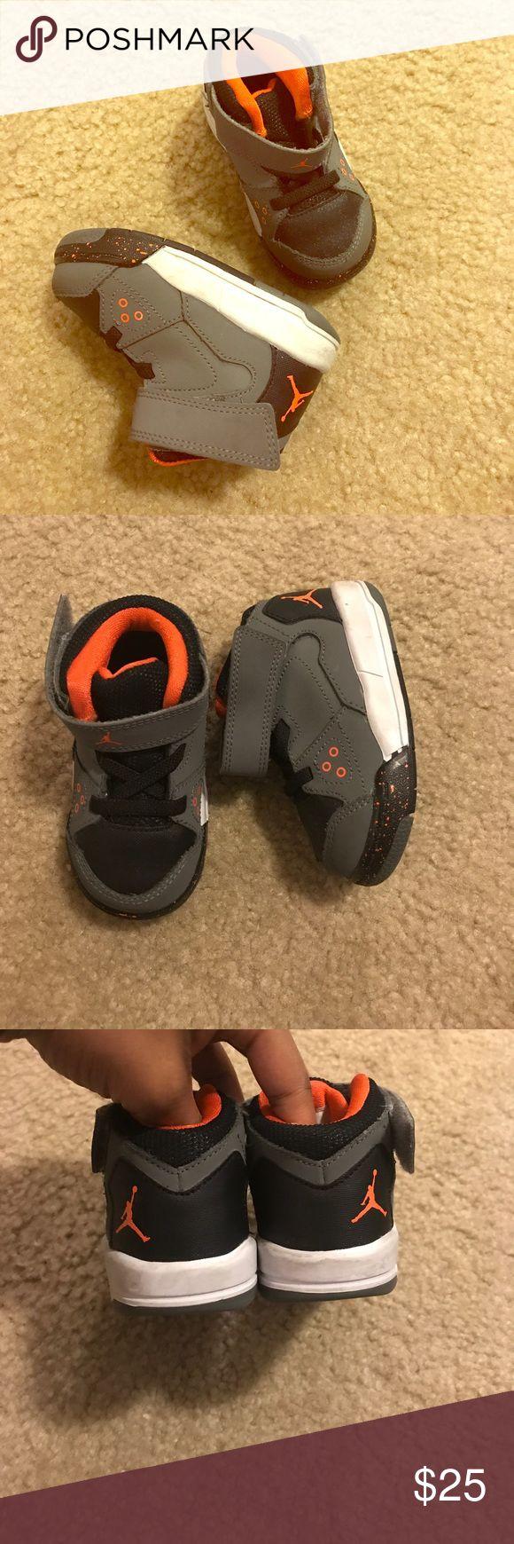 Kids baby walker Michael jordans sneakers size 5 c Kids baby walker Michael jordans (Nike air Jordan) sneakers size 5c. They are gray orange black and white. Jordan Shoes Baby & Walker
