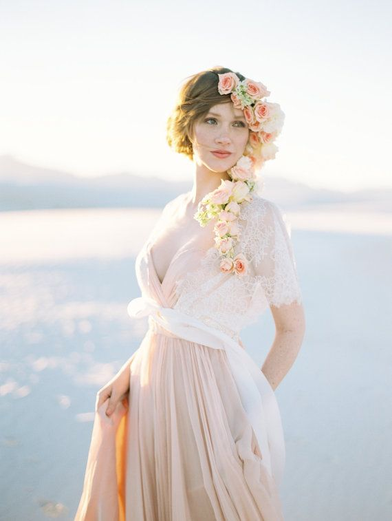 Bridal Shrug Cover up with Lace and Floral Pearl beading: I like the whole shi-bang (that's not right, is it). The hair flowers, the dress, the shrug. This is a bride. A woman enhancing her beauty in celebration of the most exhilarating day of her life.