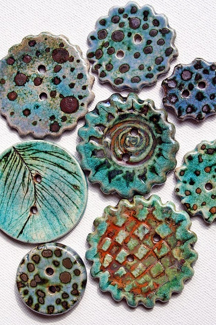 Some buttons to take an old wardrobe piece to a whole new place!   Raku Buttons by Lisa Peters Art, via Flickr