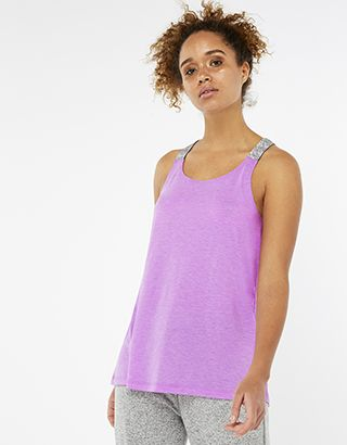Our swing vest top from the Spirit of Accessorize collection will be a total staple in your athleisure edit. In super-soft jersey, it features metallic strap...