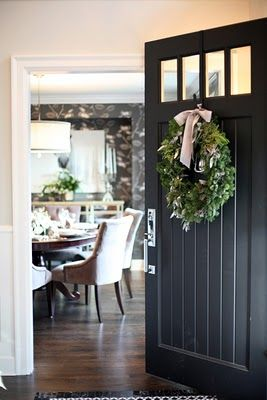 black door, wreath with oversized velvet bow.