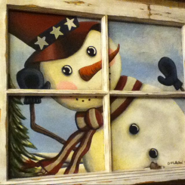 Patriotic snowman on an old window.