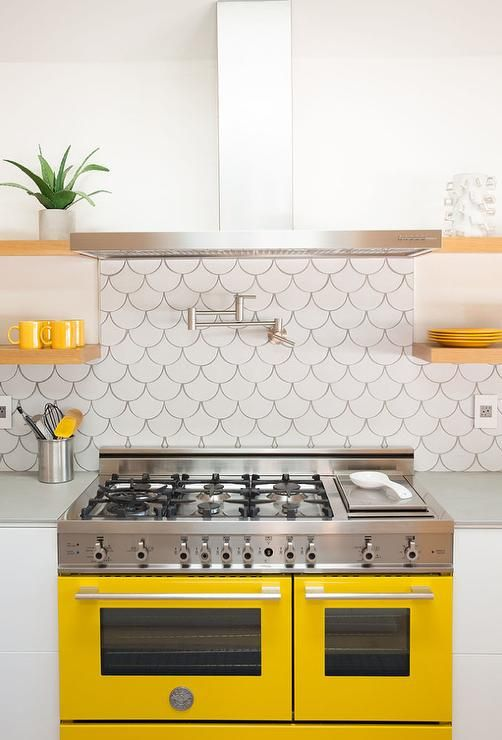 White And Yellow Kitchen Features A Stainless Steel Hood, Flanked By  Stackedu2026