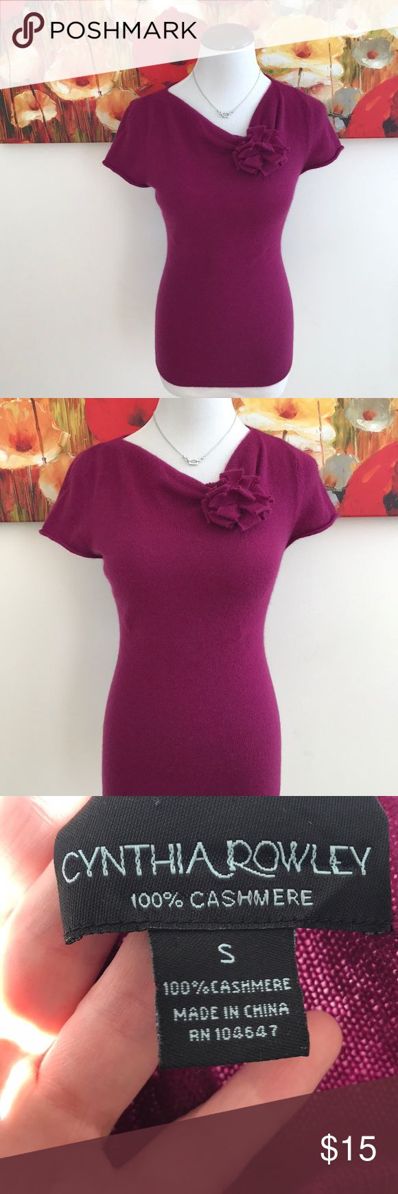 100% Cashmere Cynthia Rowley top Beautiful magenta color! Really great condition. One small hole on back on shirt. Barely noticeable and I'm sure it could be fixed. The hole is what I'm pointing at in the pictures Cynthia Rowley Sweaters Crew & Scoop Necks