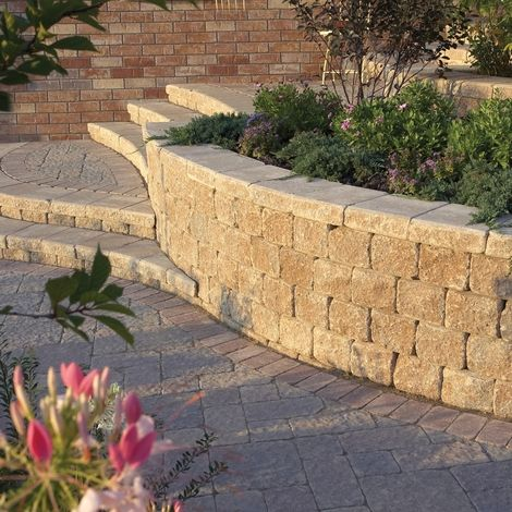 Retaining wall with steps can make a sloped yard beautiful. Call Landscape Associates (920) 337-4915 for an estimate.