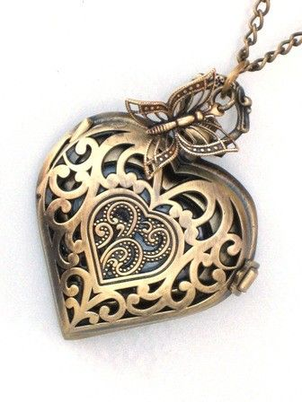 "This stunning Steampunk filigree heart pocket watch is the perfect way to say ""I Love You"". The antique brass pocket watch has a latch closure that when opened reveals a functioning time piece. The"
