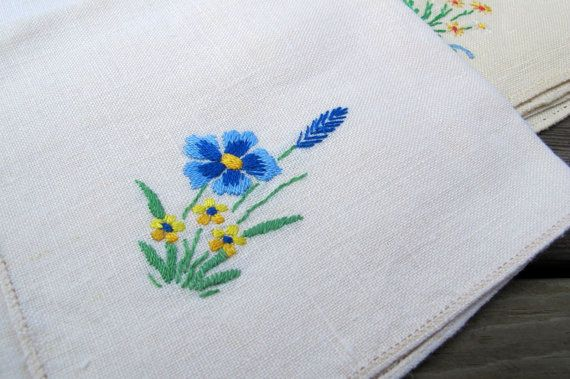 Embroidered linen napkins.  These are so pretty! You will receive the four vintage napkins shown in the photos above. Each napkin has a different flower motif hand embroidered in a corner. Just delightful! The napkins are about 11 inches square. These are used, but in excellent
