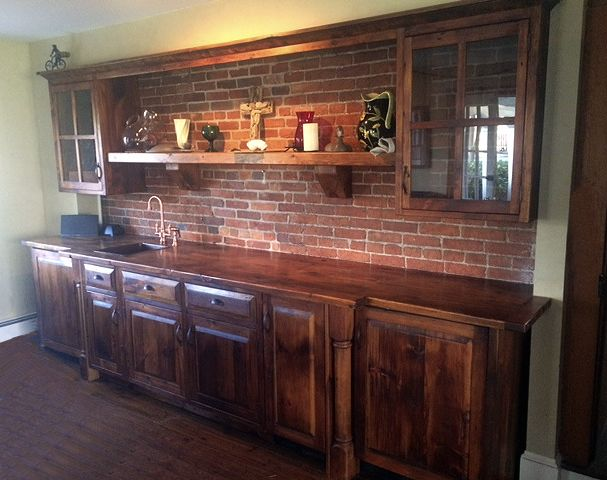 These custom made kitchen cabinets camouflage a dishwasher, wine fridge and ice maker, keeping the rich, lustrous look of the barn wood front and center. We use wood from dismantled barns and log homes dating from the 1800's to early 1900's to create rustic, one-of-a-kind, reclaimed barn wood furniture, in the heart of Amish Country, Lancaster, PA. Custom orders are our specialty. Visit our showroom located in Intercourse, PA. www.braunfarmtables.com