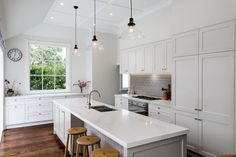 A new bulkhead creates a wall above the cabinets, which helps to anchor the kitchen visually and avoids a dust trap ...