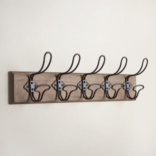 Utilize wall space with our attractive and functional Industrial Wall Rack, featuring a naturally finished wood base. Five espresso-finished hooks allow you to conveniently hang and store jackets, scarves, tote bags and more.