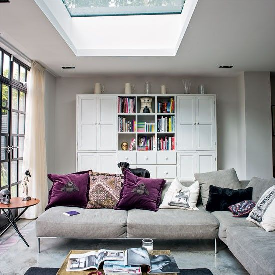 This space is kept light and bright thanks to floor-to-ceiling windows and that glorious skylight