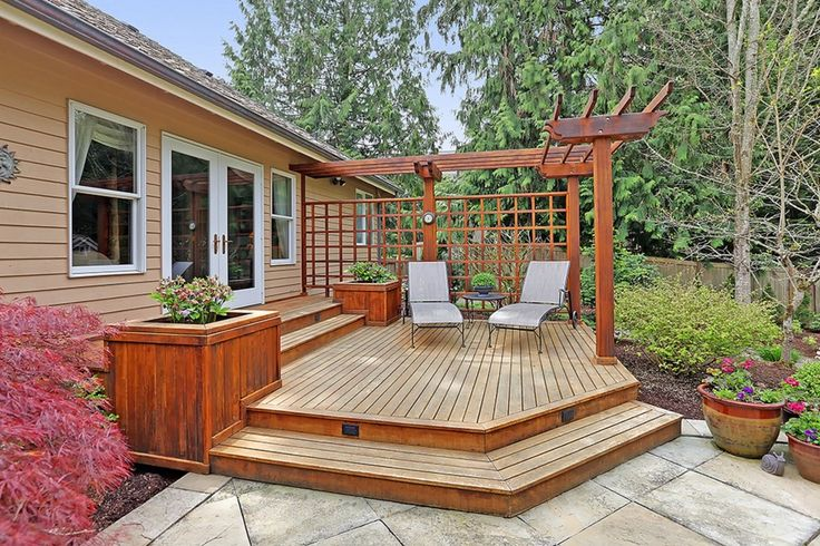 Transitional Deck with Trellis, Fence, exterior tile floors, Hinkley Lighting Horizontal Deck Light No. 1546