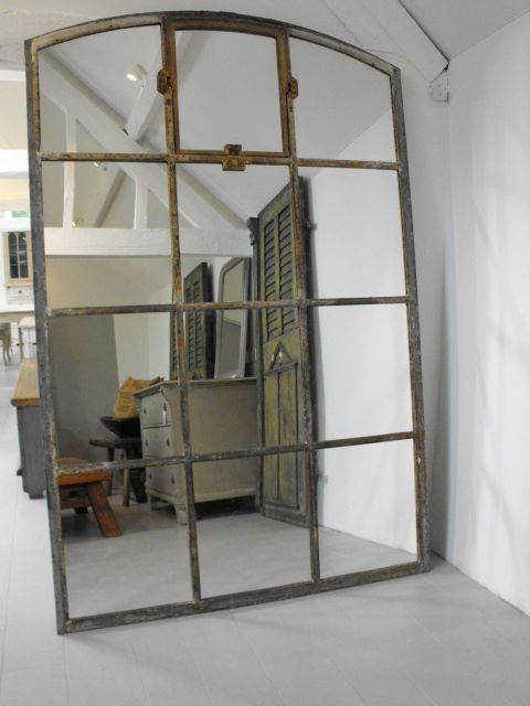 Large iron Industrial window mirror - Makes the room feel and look bigger and ties in perfectly with the industrial look