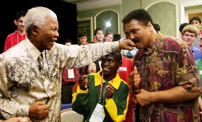 Muhammad Ali gets hard left from Madiba
