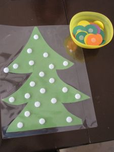 Velcro-dot Christmas Tree. Teach colors to toddlers, write on the colored disks with dry-erase markers to teach letters and numbers.
