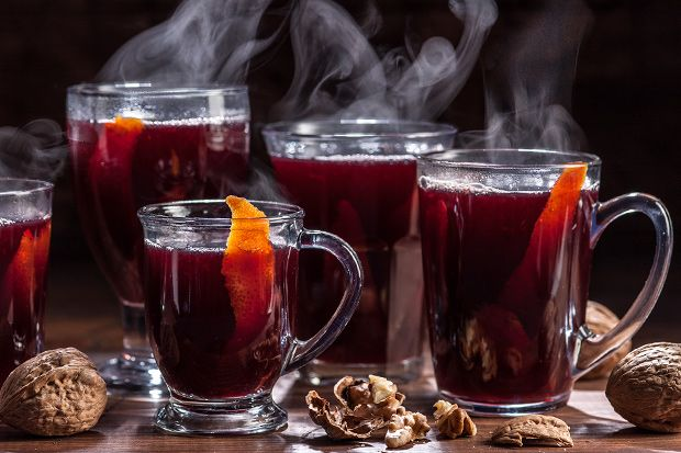 A German mulled red wine recipe with orange, lemon, spices, sugar, and a splash of brandy.