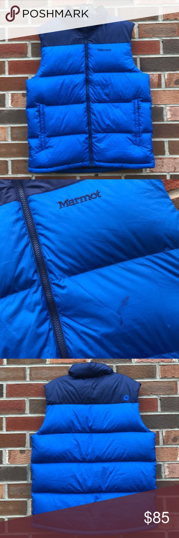 "NWT Marmot down vest men's size L New with tags! Awesome down filled blue vest, men's size L. Brand is Marmot. Has two zippered pockets on the front. Manufacturer ""flaw"" of a dark blue color in the front, see second photo. Obviously doesn't affect use! Just a materials/fabric color error. Marmot Jackets & Coats Vests"