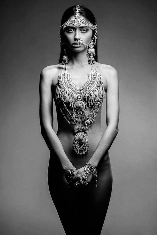 Naked women with body decoration black jewelry