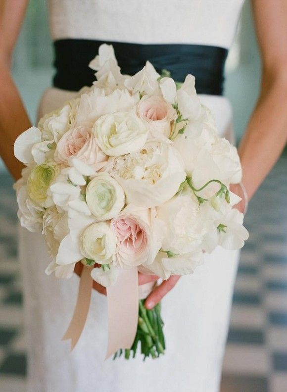the bride will carry a bouquet of ivory garden roses blush garden roses white ranunculus and ivory spray roses wrapped in ivory ribbon with the stems - Blush Garden Rose Bouquet