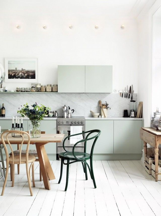 Scandinavian kitchen with mint green cabinents