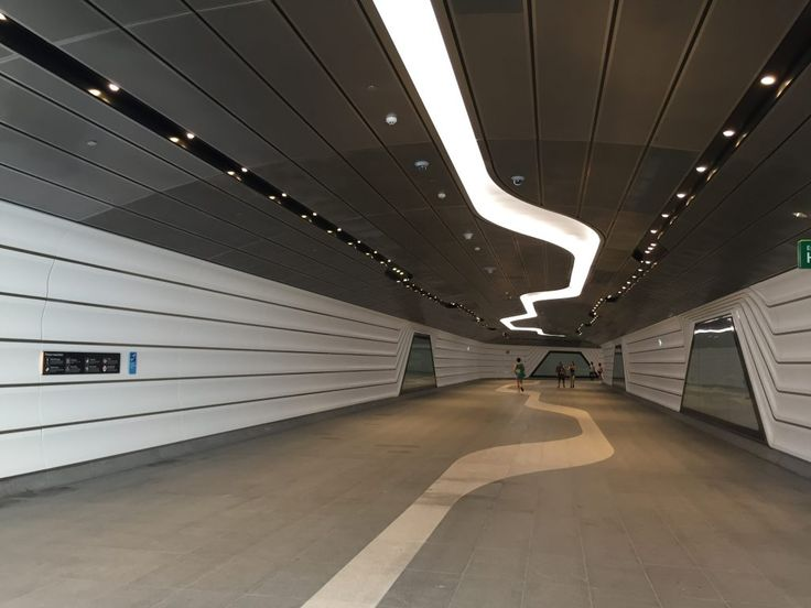 We love the fluid design of this recently opened walkway tunnel connecting Barangaroo with Wynyard Station. Arrow Metal is delighted to take part in this project supplying the #perforatedmetal panels used on the ceiling  #arrowmetal #barangarootunnel #publicspace #walkway #ceiling #acousticceiling #acoustic #wynyardtobarrangaroo