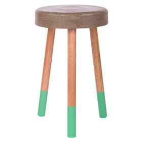 Concrete stool with aqua feet - a fun little detail.