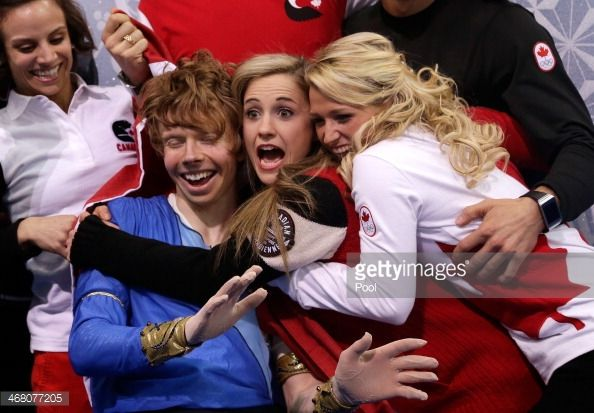 Kevin Reynolds of Canada reacts with teammates and coaches after... News Photo   Getty Images