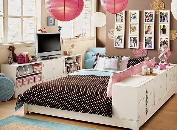 Cute, fun teen bedroom - taupe accent wall, white walls & trim; brown white  dots bed lies; large bed with dresser along one side with pillows to le