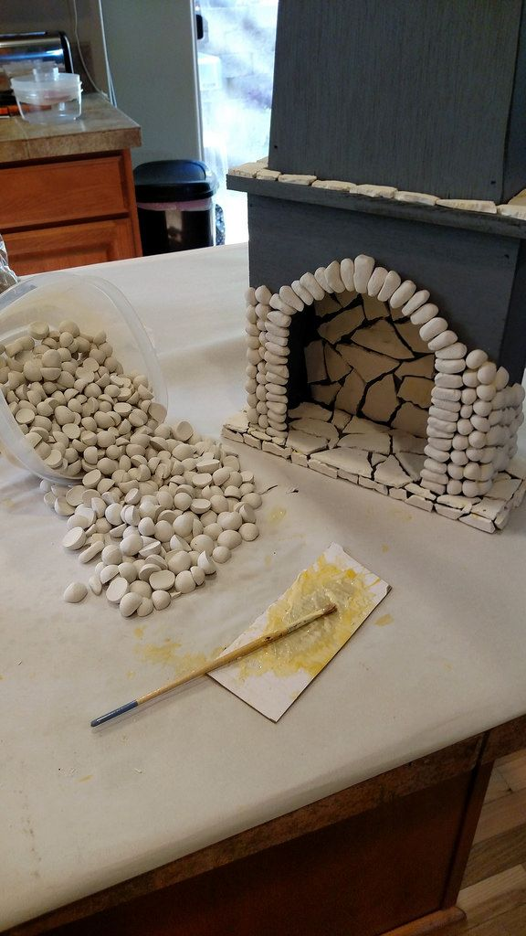 Flat polymer clay rocks are inside, elongated rocks are used to frame the entrance, then all the rounded river rocks cover the remainder of the fireplace - Explore Ken Haseltine Regent Miniatures' photos on Flickr.